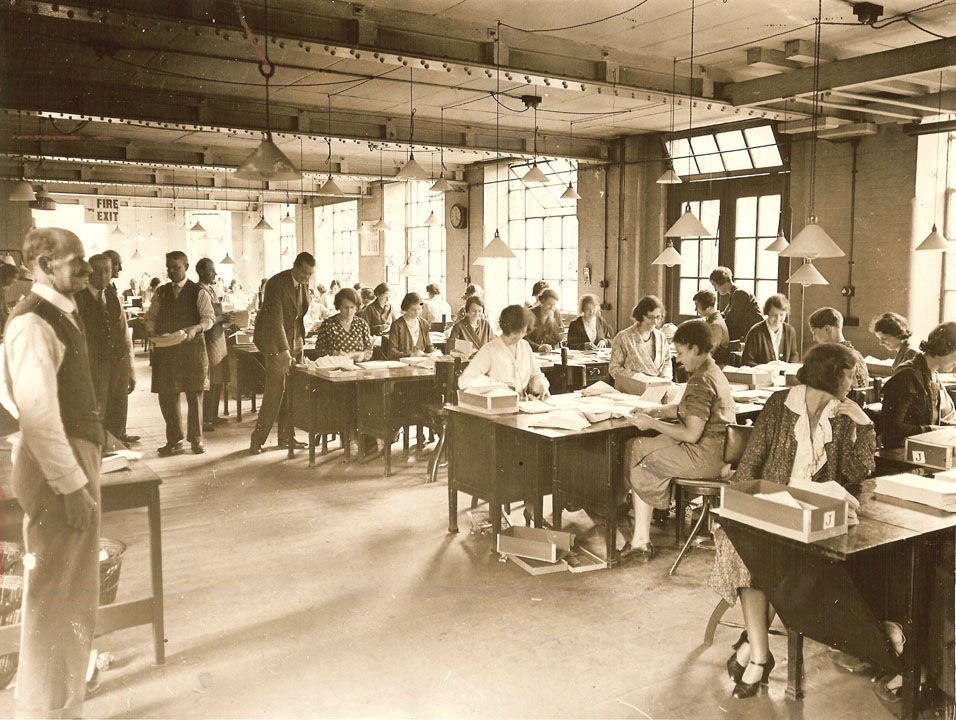 Old photograph of office workers in a 1932 workplace