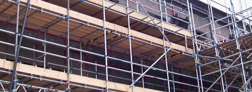 Image shows scaffolding on construction site