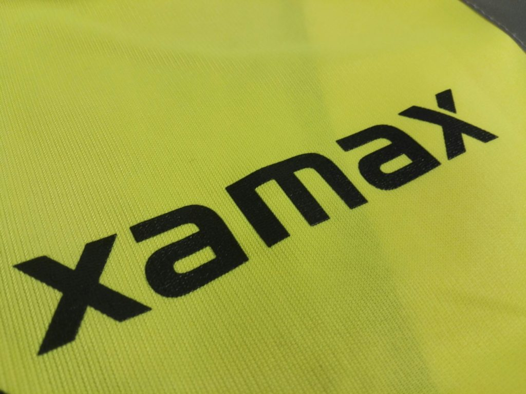 Image shows Xamax logo screen printed on a hi-vis vest