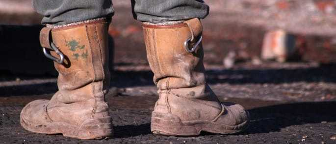 Image shows man wearing rigger boots