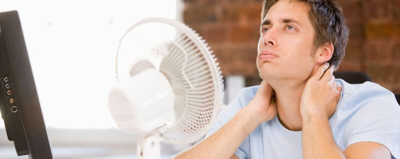 warm man infront of fan