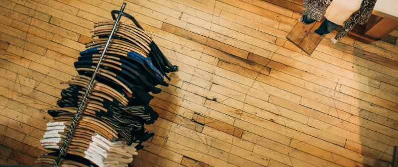 Photo of a clothing rack on a wooden floor taken from above