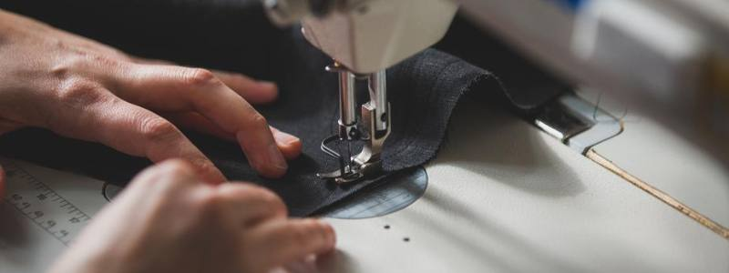 Close up photo of somebody using a sewing machine