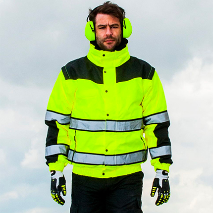 Man wearing high visibility jacket and ear defenders