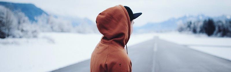 Man wearing a red hoodie in winter landscape