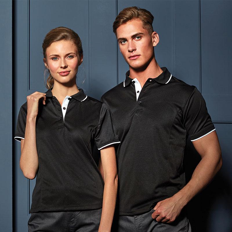 Woman and Man wearing matching polo shirts