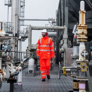 Engineer in an industrial setting wearing class 3 hi vis clothing