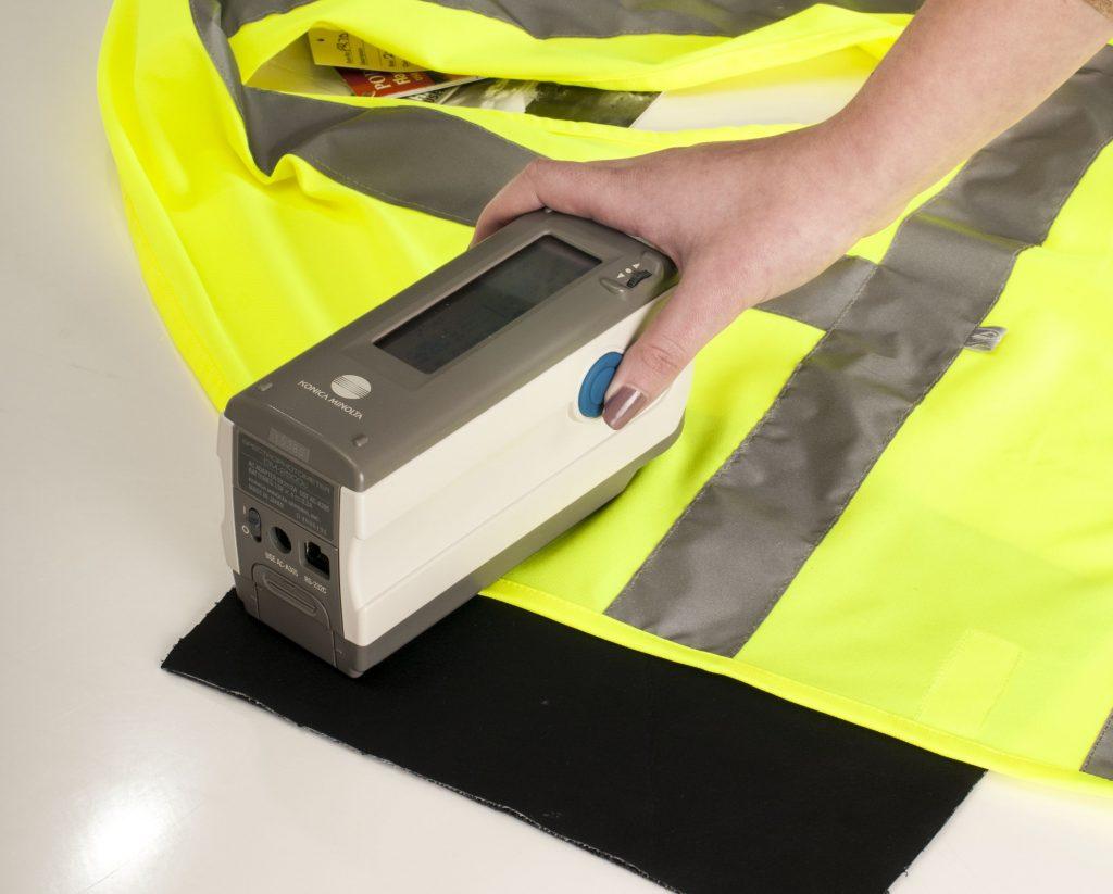 Testing the fluoresence of hi vis yellow fabric